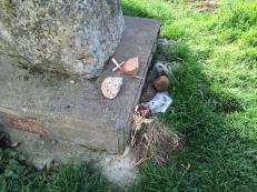 Remembrances at base of Memorial Cross