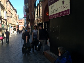 Musicians heading into the Cavern Club. Mathews Street in the background.