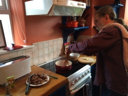 Mike cooking lamb stew.